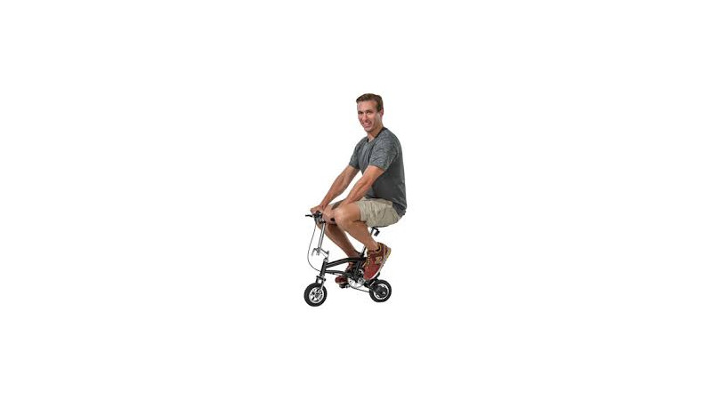 Man riding a silly small bicycle.